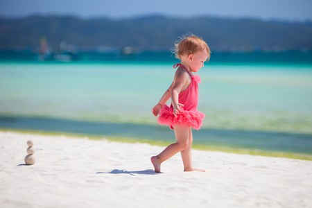 Toddler girl playing at beach