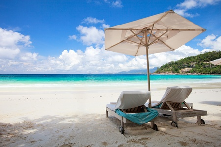 Beach chair on perfect tropical white sand beach
