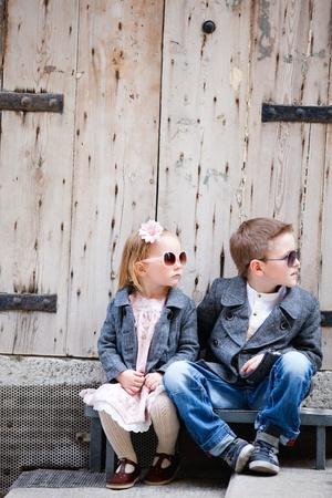 Foto de Brother and sister outdoors in city on beautiful spring day - Imagen libre de derechos