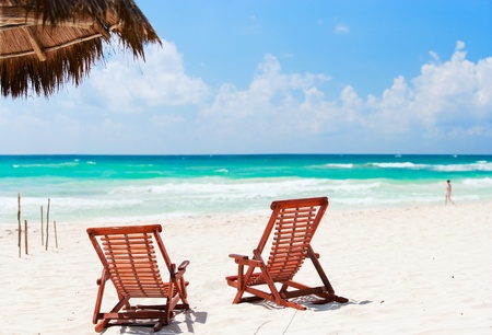 Two beach chairs on beautiful Caribbean coast