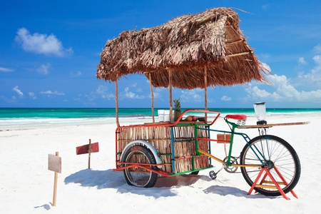 Photo for Exotic beach bar transformed from bike at Caribbean beach in Mexico - Royalty Free Image
