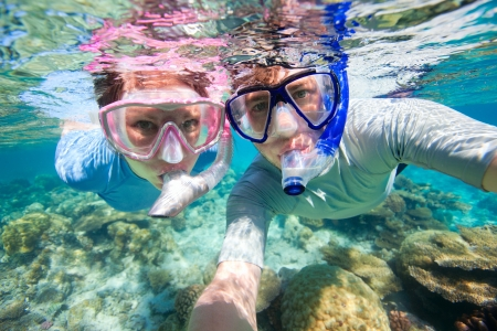 Underwater photo of a couple snorkeling in ocean