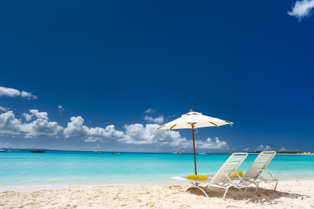 Photo for Chairs and umbrellas on a beautiful Caribbean beach - Royalty Free Image