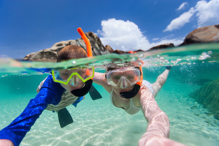 Split photo of mother and son family snorkeling in turquoise ocean water at tropical island