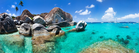 The Baths beach area major tourist attraction at Virgin Gorda, British Virgin Islands with turquoise water and huge granite boulders