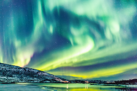 Photo for Incredible Northern lights Aurora Borealis activity above the coast in Norway - Royalty Free Image