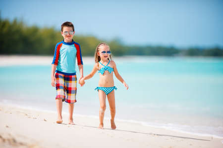 Photo for Kids brother and sister enjoying time at tropical beach - Royalty Free Image