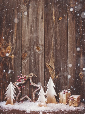 Foto de Christmas decoration over wooden background - Imagen libre de derechos