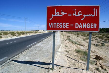 Red sign danger on the road in south part of Tunisia
