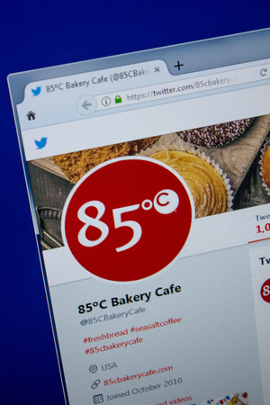 Ryazan, Russia - July 11, 2018: Twitter of 85C Bakery Caf? website on the display of PC