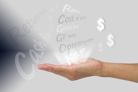Man's hand showing financial terms on gradient background, financial business concept