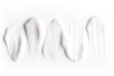 Photo pour A group of textured strokes of moisturizers on a white background. - image libre de droit