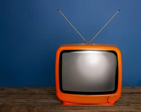 Foto de old bright vintage tv with blank screen and antenna on dark background - Imagen libre de derechos