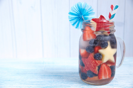 Patriotic drink cocktail with strawberry, blueberry and apple