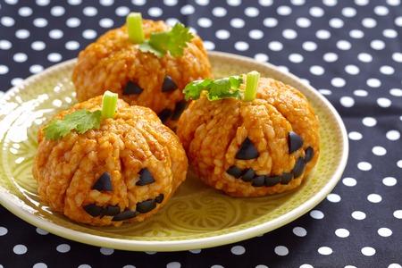 Foto de Pumpkin Rice Ball Jack O Lanterns for Halloween party - Imagen libre de derechos