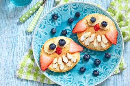 Photo for Funny owl pancakes with berries for kids breakfast - Royalty Free Image