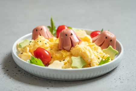 Foto de Octopus sausage with scrambled eggs served for kid breakfast - Imagen libre de derechos