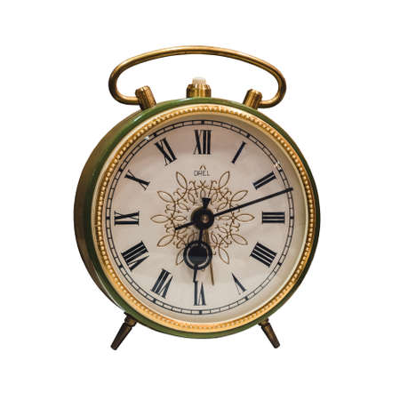 Photo pour old green and golden color alarm clock with roman numerals in the museum. Isolated - image libre de droit