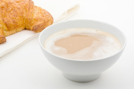 Cafe au lait with butter croissant over white background