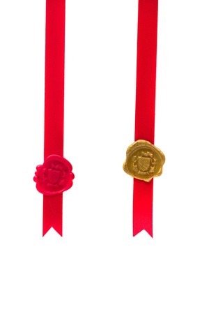 Red and gold wax seal with ribbon over white background