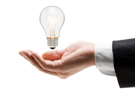 Business man holding light bulb in his hand - creativity concept