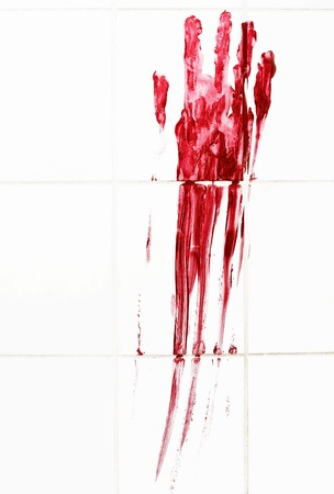 Bloody handprint with streaks on bathroom tiles: Royalty
