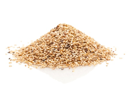 Heap of organic natural sesame seeds over white background