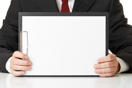 Businessman holding clipboard with empty piece of paper for copy or images