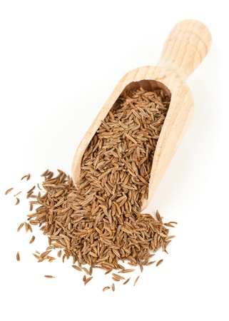 Caraway  Cumin seeds in wooden scoop over white background