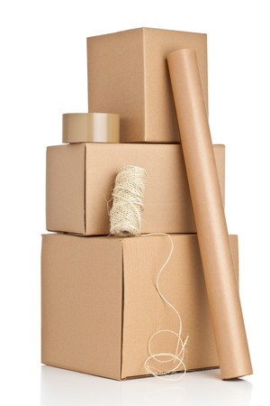 Brown carton boxes with packaging materials on white background