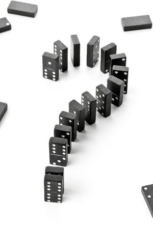 Domino game stones forming question mark - risk, challenge or uncertainty concept