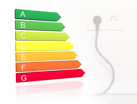 Photo for New 2019 european energy efficiency classification label with classes from A to G in front of cable plugged into wall socket background - Royalty Free Image