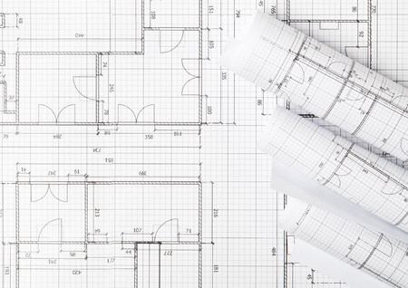 Photo pour Rolls of architectural blueprint house building plans on blueprint background on table flatlay top view from above - image libre de droit