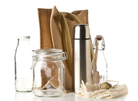 Photo for Zero waste or waste free shopping utensils with burlap bag, glass bottles and cotton bag over white background - waste reduction eco lifestyle or bulk buy grocery concept - Royalty Free Image
