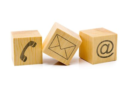 Photo pour Contact us symbols with phone, e-mail and envelope icons on three cubes on white background - image libre de droit