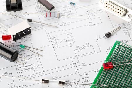 Photo pour Different electronic parts or components on pcb wiring diagram background with resistors, capacitors, diode and ic chips, with copy space, selective focus - image libre de droit