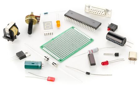 Photo for Different electronic parts or components on white background with resistors, capacitors, diode and ic chips, selective focus - Royalty Free Image