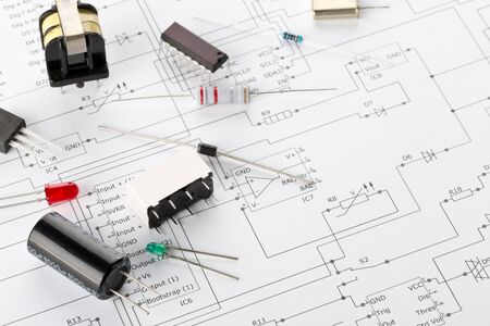 Photo for Different electronic parts or components on pcb wiring diagram background with resistors, capacitors, diode and ic chips, with copy space, selective focus - Royalty Free Image