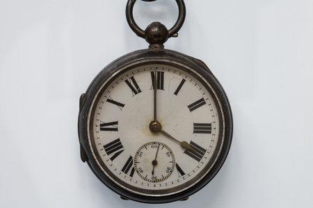 Photo pour Antique pocket watch with roman numerals on a white background - image libre de droit