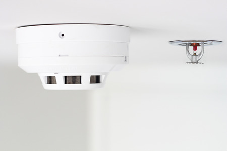 Photo for smoke detector and pendent fire sprinkler on a ceiling - Royalty Free Image