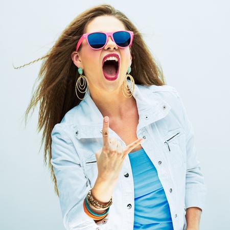 Foto de Screaming fashion model studio portrait. Long hair. Rock style. - Imagen libre de derechos