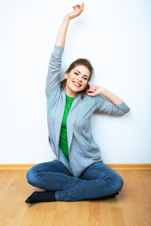 Photo pour Woman natural portrait seatting on a floor. White background isolated. Smiling girl. - image libre de droit