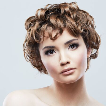 Foto per Woman beauty portrait. Close up woman face isolated on white. Beautiful girl with short hair. - Immagine Royalty Free