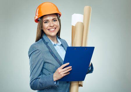 Photo pour Smiling woman architect holding paper plans  and clipboard. Isolated portrait. - image libre de droit