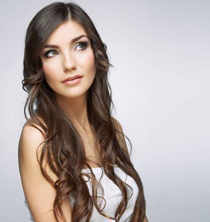 Foto de Beauty woman face close up portrait. Girl with long hair looking up side. Female model studio portrait. - Imagen libre de derechos