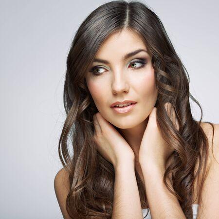 Foto de Beauty style face portrait of young woman looking side. Female model studio posing. - Imagen libre de derechos