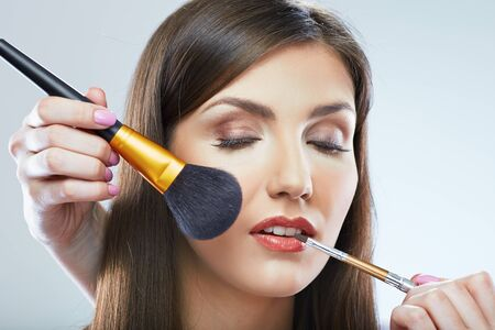 Photo for Beautiful woman faceclose up portrait. Make up applying with brush. Isolated. - Royalty Free Image