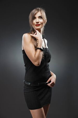 Foto de Woman fashion beauty portrait. Evening black dress. - Imagen libre de derechos