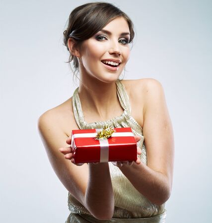 Photo pour Beautiful woman portrait hold gift in christmas color style . Smiling happy girl on white background. - image libre de droit