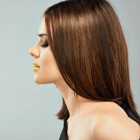 Photo pour Profile portrait of young beautiful woman with straight hair. - image libre de droit